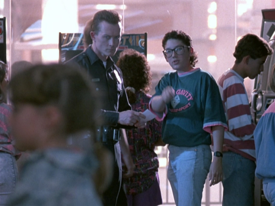 A kid at the game arcade telling the T-1000 where John